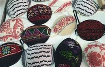 كمامات الفلسطينيين بألوان الكوفية والعلم في القدس