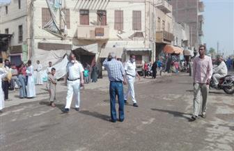 فض تجمعات وتحرير 18 محضرا و29 إزالة في حملة بإسنا في الأقصر | صور
