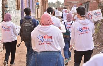 فروع القومي للمرأة  توزع المساعدات مع جمعية رسالة | صور