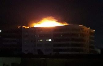 حريق ببرج سكني بشارع الجيش بالسويس