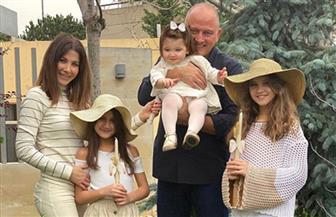 ظهور جديد لنانسي عجرم مع زوجها وبناتها يحتفلون بـ«أحد الشعانين» | صور