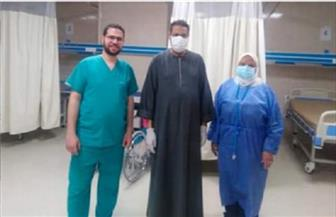 خروج حالتين من مستشفى العزل بإسنا بعد شفائهما من كورونا | صور