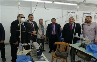تصنيع الملابس الوقائية لأطباء مستشفيات الحجر الصحي بجامعة حلوان | صور