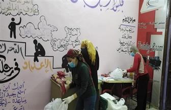 """""""الشباب المصري"""" ببورسعيد يوزعون سلعا غذائية لـ 150 أسرة من العمالة اليومية   صور"""