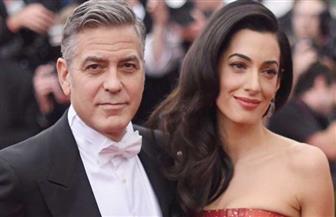 جورج كلوني وزوجته يتبرعان بأكثر من مليون دولار لمكافحة كورونا