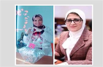 وزيرة الصحة تطمئن على مديرة عزل العجمي هاتفيا بعد إصابتها في العمل|صور