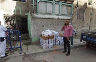 «تضامن بورسعيد»: توزيع 100 كرتونة مواد غذائية على أسر 3 عقارات تحت الحجر الصحي | صور