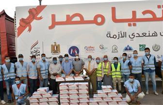 """محافظ أسوان يشهد توزيع مواد غذائية ضمن مبادرة """"نتشارك هتعدي الأزمة"""""""