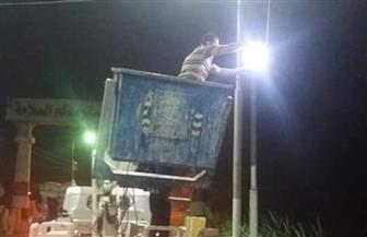 صيانة محولات وأعمدة الكهرباء خلال ساعات حظر التجوال في أخميم | صور