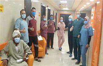 خروج 20 حالة تعافت من فيروس كورونا من مستشفى العزل بإسنا جنوب الأقصر | صور