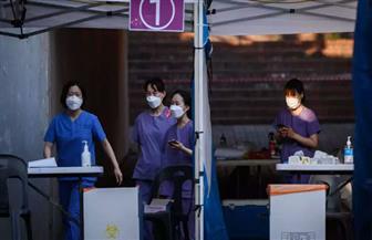 كوريا الجنوبية  تشدد القيود المفروضة لاحتواء كورونا مع ظهور موجة جديدة من الوباء