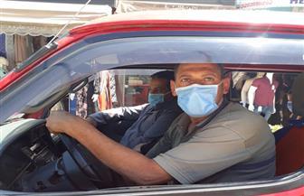 اتخاذ الإجراءات القانونية تجاه سائقي مركبات الأجرة حال وجود أى راكب بدون كمامة طبية