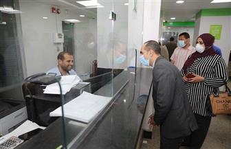 نائب محافظ سوهاج يتفقد صرف المعاشات بمراكز البريد | صور