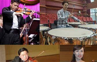 """فنانون صينيون ومصريون يعزفون """"سيمفونية سحابية"""" عابرة للحدود على موسيقى """"مسيرة النصر"""""""