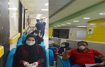 خروج 9 مصابين بفيروس كورونا من مستشفى العزل بإسنا الأقصر بعد تعافيهم | صور