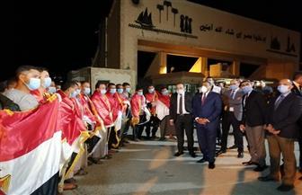 وصول 23 مصريا كانوا محتجزين بمدينة ترهونة الليبية إلى منفذ السلوم| صور