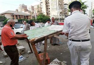 إزالة الباعة الجائلين بمحطة ترام كليوباترا بالإسكندرية | صور