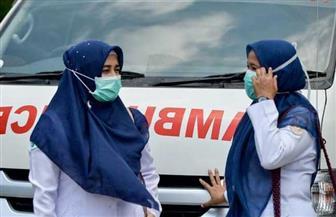 معاقبة منتهكي نظام الكمامات في إندونيسيا بوضعهم في توابيت