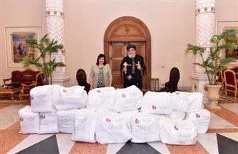 الكنيسة القبطية تقدم ملابسا واقية للأطقم الطبية المعالجة لكورونا