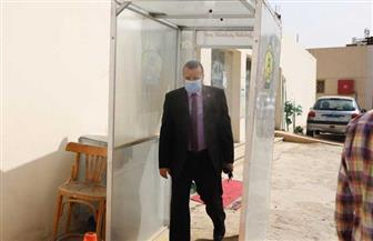 وزير القوى العاملة يتابع الإجراءات الاحترازية للعاملين عبر بوابة التعقيم | صور