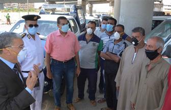 ضبط 324 قائد سيارة أجرة لعدم الالتزام بارتداء الكمامة بمراكز المنيا