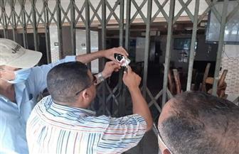 إغلاق وتشميع مقهيين بحي الضواحي في بورسعيد لمخالفتهما مواعيد الإغلاق| صور