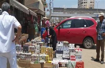 فض سوق بنزايون والشون فى المحلة الكبرى لمخالفة الإجراءات الاحترازية  صور