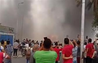 ١٨ سيارة إطفاء تشارك فى إخماد حريق سوق توشكى بحلوان