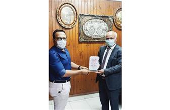 «صحة الغربية» تكرم مدير مستشفى العزل بكفرالزيات بعد ترقيته | صور