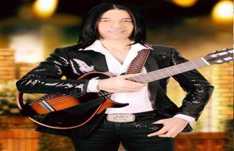 عازف جيتار مصري يفوز في مسابقة دولية لموسيقى السينما والتليفزيون بإنجلترا|  صور