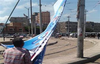إزالة لافتات مرشحي مجلس الشيوخ من أحياء غرب الإسكندرية | صور