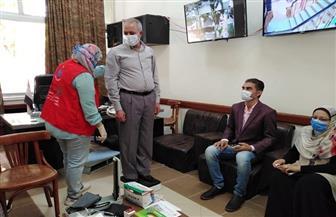 سكرتير عام محافظة قنا يتابع أعمال مبادرة 100 مليون صحة | صور