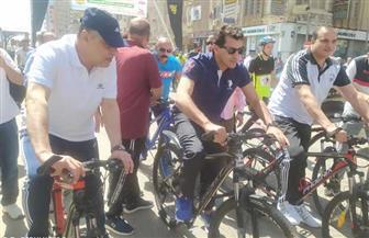 وزير الشباب والرياضة يشارك فى ماراثون للدراجات بسوهاج | صور
