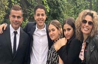 في رأس السنة.. دينا الشربيني ترد على صور عمرو دياب وعائلته
