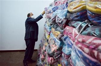 رئيس جامعة بني سويف: توزيع 1200 بطانية على العمال | صور