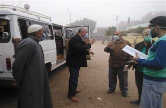 الأمن ينفذ قرار تطبيق الغرامة على غير الملتزمين بارتداء الكمامة في أسوان| صور