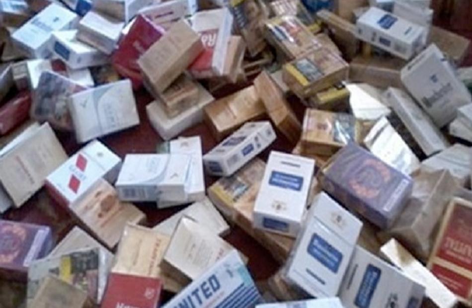 ضبط أكثر من  ألف عبوة سجائر مجهولة المصدر داخل محل بالقليوبية