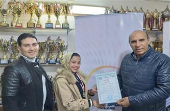 نادي الشرق ببورسعيد يكرم اللاعبة سمر هشام لحصولها على برونزية بطولة الكونغ فو| صور