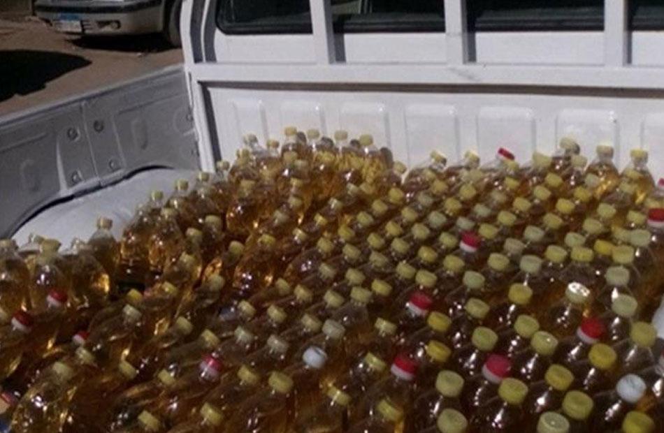 ضبط  طن زيت طعام بدون بيانات داخل مخزن لتجارة السلع بالقاهرة