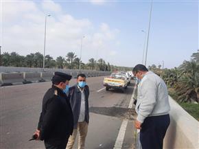 هبوط أرضي بكوبري الشيخ مبارك العلوي على الطريق الدولي الساحلي | صور