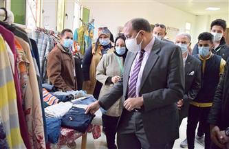 رئيس جامعة بني سويف يفتتح معرضًا خيريًا للملابس بكلية علوم ذوي الاحتياجات الخاصة | صور