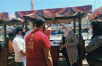 حملة لتوعية المواطنين بأهمية ارتداء الكمامات بشارع الشيراتون بالغردقة   صور