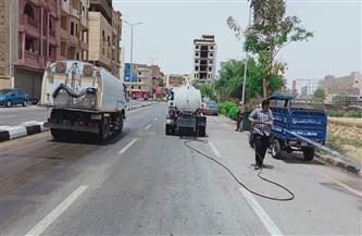 حملة نظافة وغسيل الأرصفة بشوارع حي جنوب مدينة الأقصر|صور
