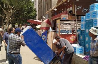حي السويس يشن حملة لإزالة الإشغالات والتعديات على الطريق العام |صور
