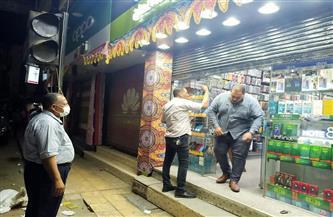تحرير 30 محضر مخالفة مواعيد غلق بأسيوط  صور