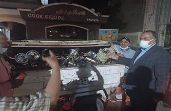 تحرير 12 محضرًا ومصادرة شيش من المقاهي لمخالفة الإجراءات الاحترازية بأسيوط   صور