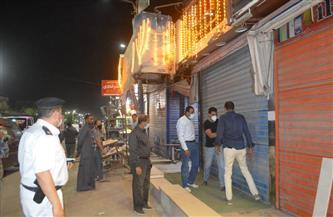 غلق 65 مقهى وورشة ومحلًا تجاريًا لعدم الالتزام بالإجراءات الاحترازية بالفيوم| صور