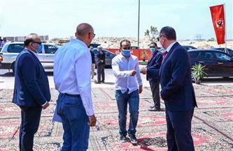 عبدالحفيظ ورباعي فريق الكرة يحضرون احتفالية وضع حجر أساس إستاد الأهلي