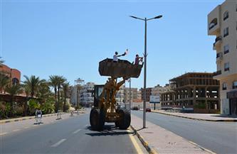 تركيب كشافات وصيانة أعمدة إنارة في عدد من قرى قطور
