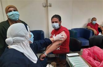تطعيم 30 موظفا من حي العجوزة بلقاح كورونا |صور